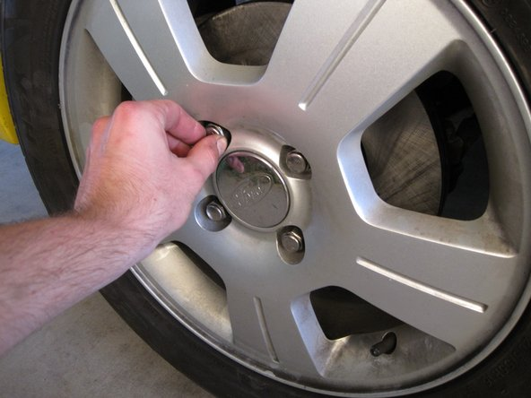 Put the wheels back on the car and hand tighten the lug nuts.