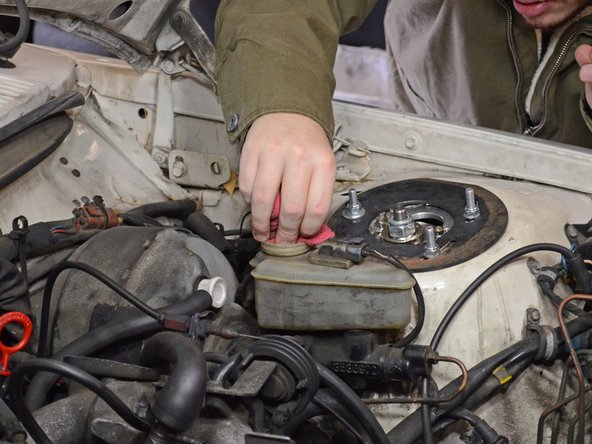 Image 3/3: When you remove the rag, be sure not to place it on any painted or plastic surfaces. Brake fluid will strip paint and deteriorate plastic.