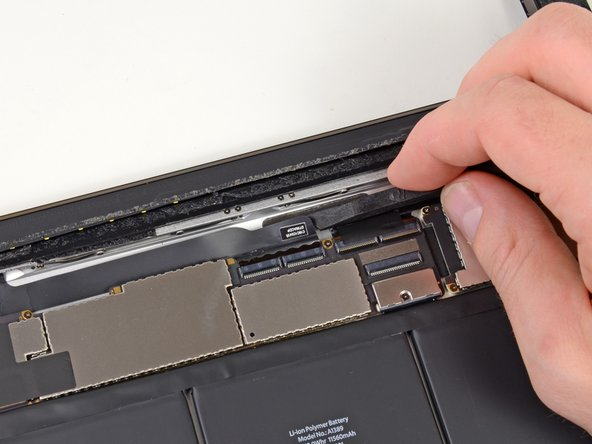 Image 1/2: Pull the digitizer ribbon cable straight out of its sockets on the logic board.