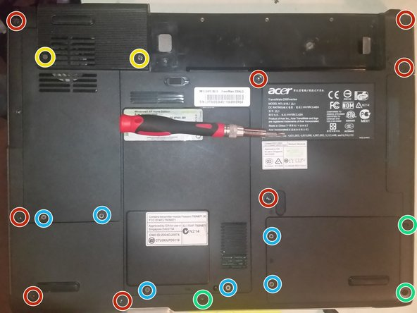 Flip the laptop over, and remove the two screws securing the fan cover, and then remove the two screws hidden by the cover.