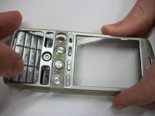 Hold the phone with the keypad facing up and gently push on the keypad with one finger to dislodge it from phone.