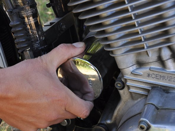 Carefully thread your new oil filter into place, turning it in a clockwise direction. Do not overtighten your filter. Only turn the filter a 1/2 turn past the point where you start to feel resistance from the gasket contacting the engine.