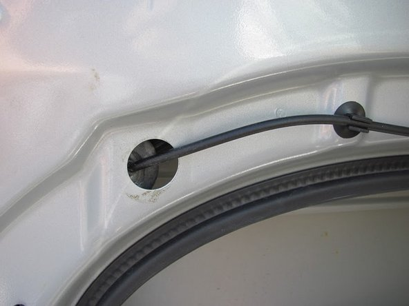 Peel out the rubber, which holds the door lock, from the door panel.