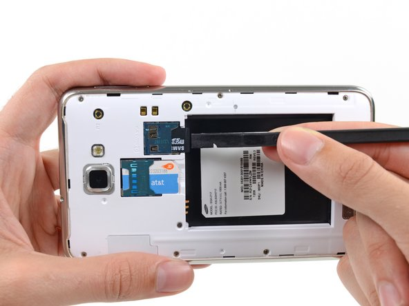 For reassembly, push the microSD card into the slot until it clicks in place.