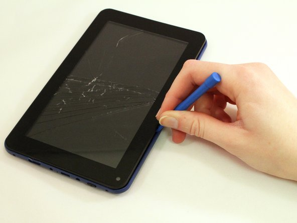 Use the blue opening tool to pry the tablet open.