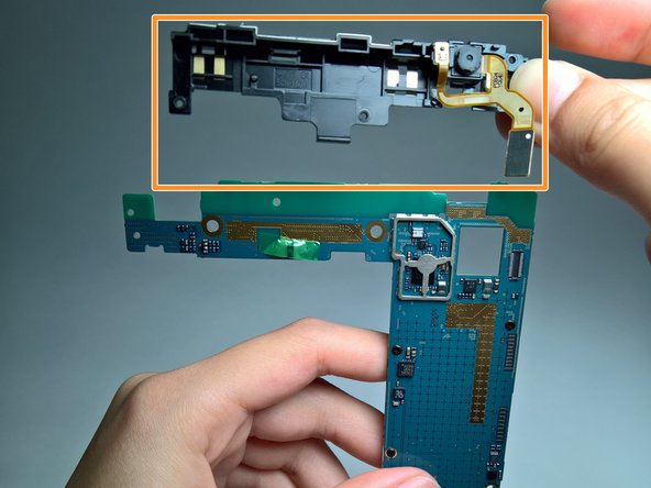 Remove the EMI shield from the motherboard.
