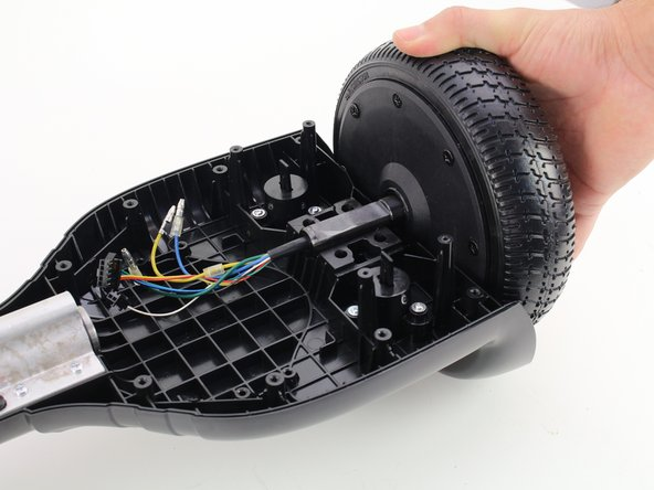 Lift motor assembly away from hoverboard.