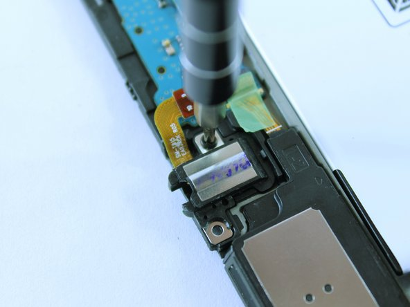 Remove the black 3mm screw using a PH000 Phillips screwdriver.