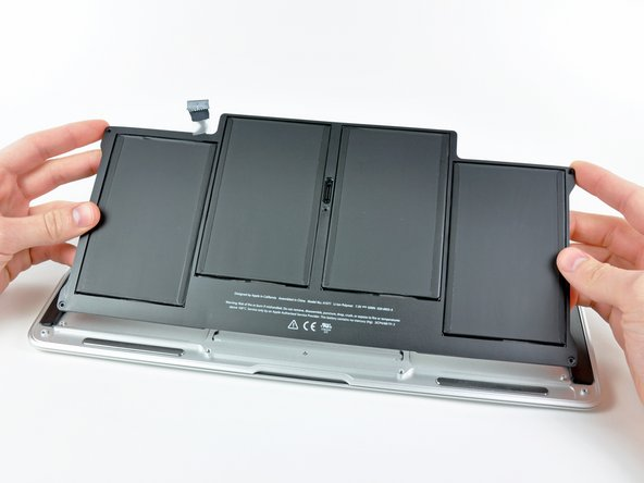 Image 1/1: Lift the battery from its edge nearest the logic board and remove it from the upper case.