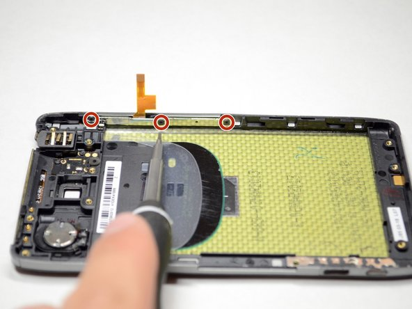 Remove the three 3.5mm Torx T3 screws holding the power/volume button cable to the side of the frame.