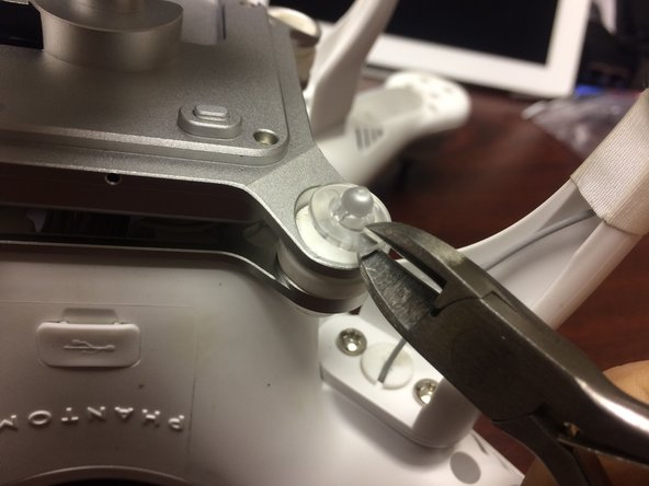 There are four tabs on the retaining clip. I simply took my wire cutters and removed one of those tabs.