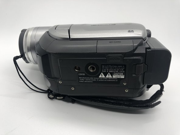 Remove one 5mm screw on the bottom side of the camera with a Phillips #0 screwdriver.