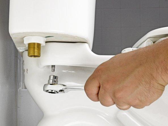When reattaching the tank, tighten the bolts with a screwdriver, rather than tightening the nuts. Alternately tighten each bolt in increments, until the tank fits snugly against the toilet.