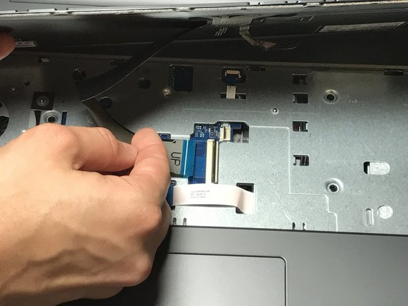 Afterwards, carefully slide the cable out of its slot.