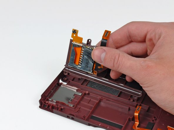 Lift the SD board and the stylus holder out of the case.