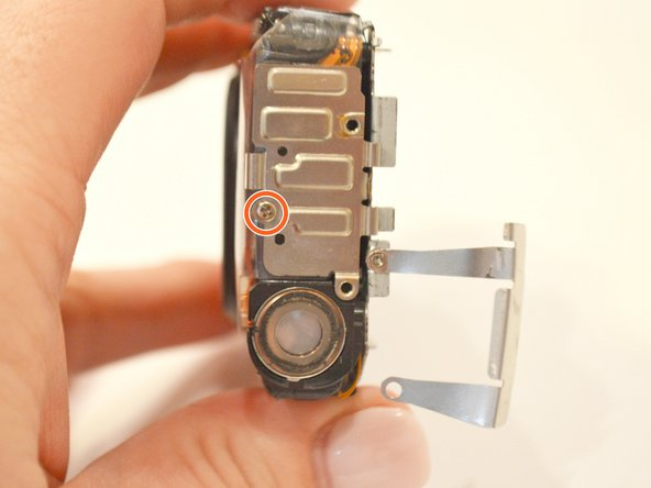 Swivel the bracket away from the body of the camera, and remove the remaining 1.8mm screw underneath.