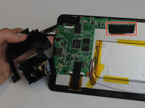 Start by peeling back the black electrical tape covering the motherboard components