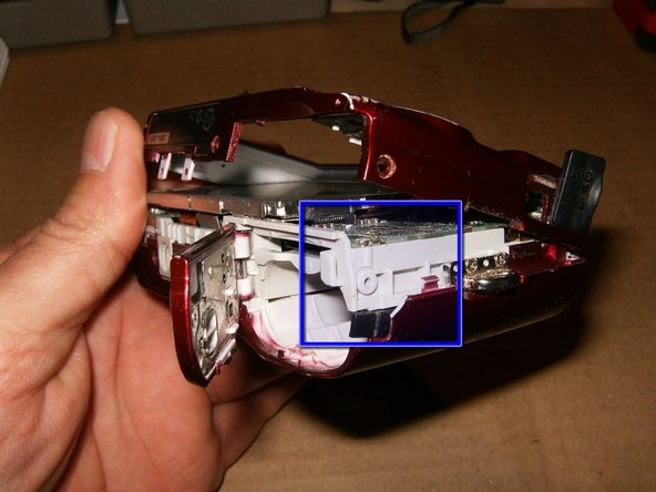 Separate the rear cover from the front by simply gently pulling the two halves apart. You may have to use your fingernails to separate them. Start at the bottom side, by the AC Power cover. Work your way around the bottom.