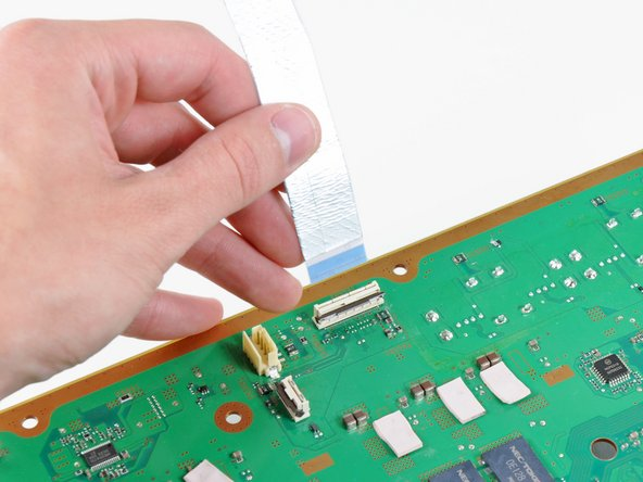 Remove the Wi-Fi/Bluetooth ribbon cable from the motherboard.