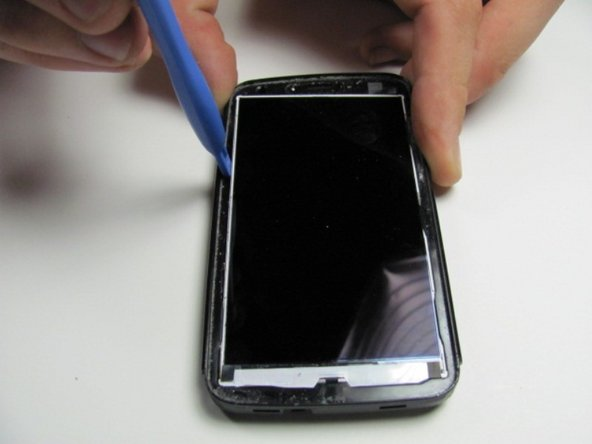 Image 1/3: Using a plastic opening tool, slide it in between LCD screen and the case of the phone and then pry it out carefully.