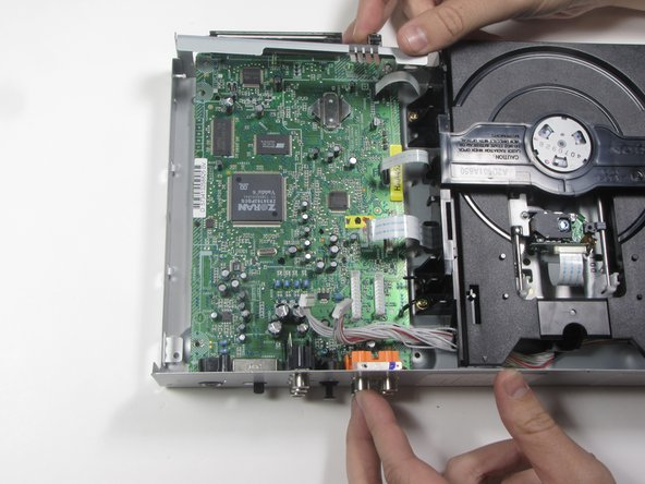 Push the motherboard forward a couple inches to detach it from the casing.