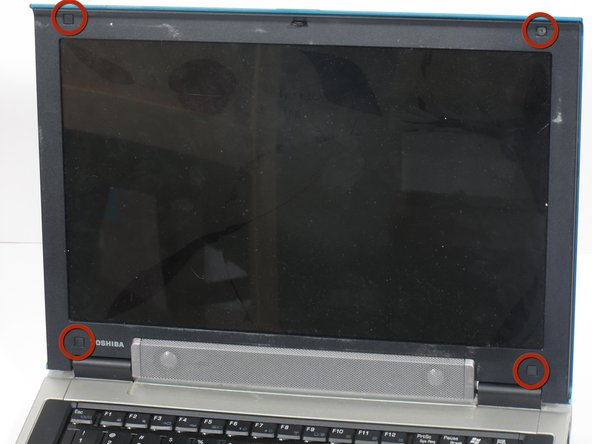 The laptop displayed in the picture does not have these plastic squares.
