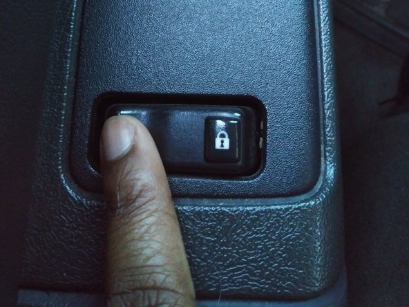 Press and hold the unlock button on the driver side door. Do not release until prompted to do so in Step 10.