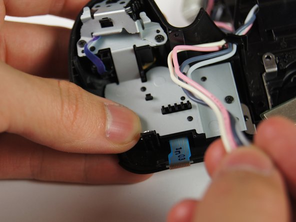 Remove the four wires (white, pink, dark blue, light blue) from the holder with your hands.