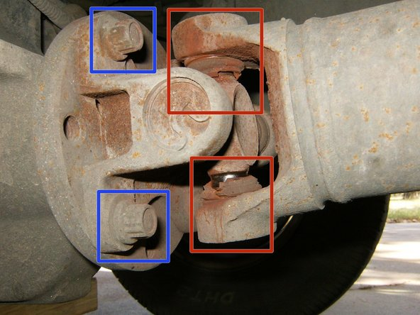 The damaged U-joint is clearly visible.