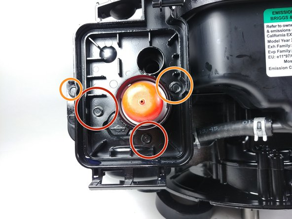 Locate the four bolts holding the air filter housing to the engine. Remove these bolts using the ratchet driver and the appropriately sized socket.