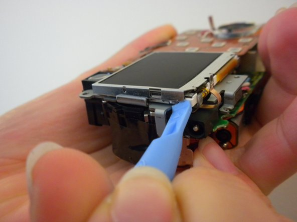 Remove the metal frame from the LCD screen using a spudger.