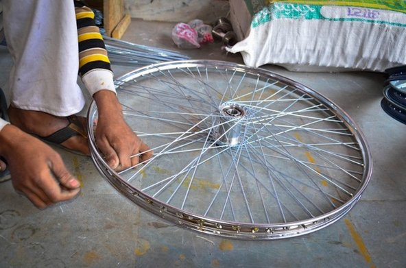 Rickshaw repair at a shop in Delhi