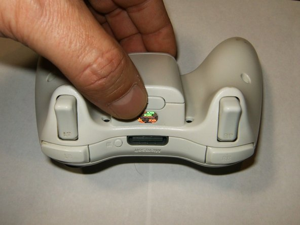 Depress the battery release button on the top of the controller. Remove the battery holder from the controller.