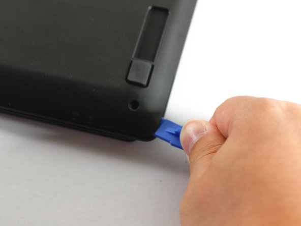Use a plastic opening tool to carefully remove the back panel.