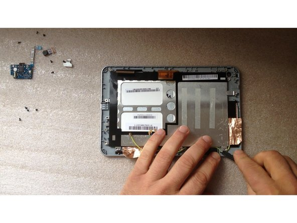 lift the screen shield from one side and open it like a door, then remove it.