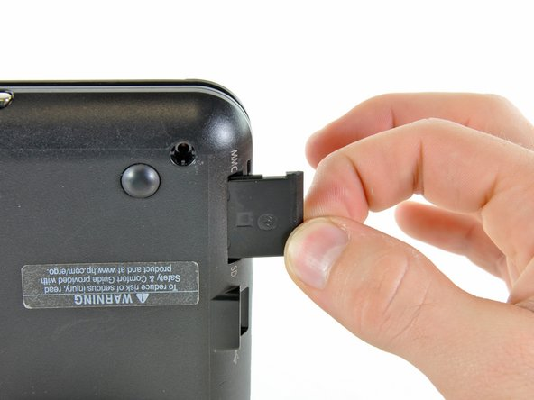 Pull the SD card out of the lower case.