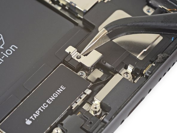 Remove the bracket covering the Taptic Engine flex cable connector.
