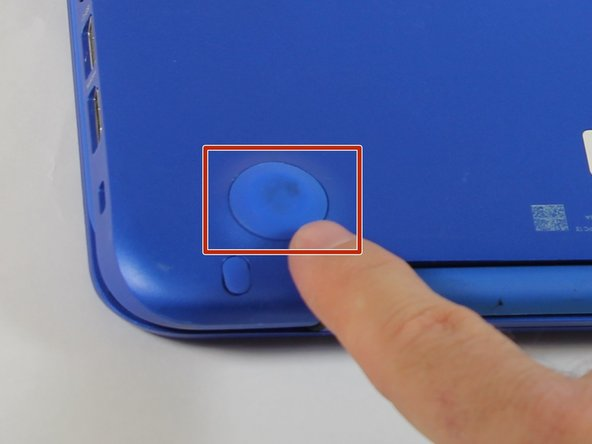 Use a pick to remove the two (2) large computer feet along the back edge of the device.