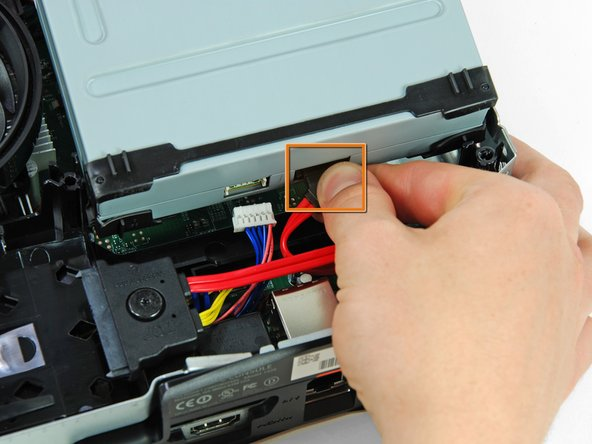 Disconnect the power cable from the back of the optical drive.