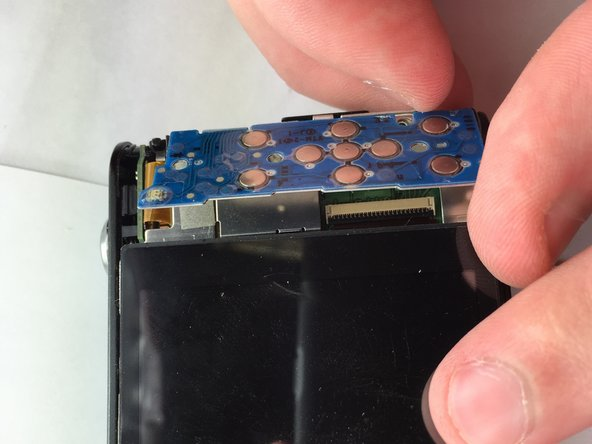 Image 1/2: Pull the tape connection to disconnect the back button control from the rest of the camera