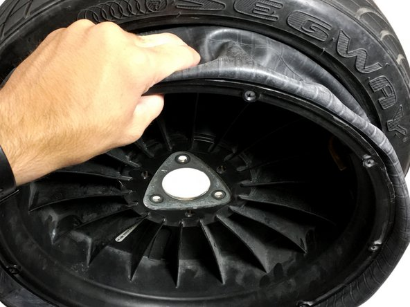 Wrap the new inner tube around the rim.