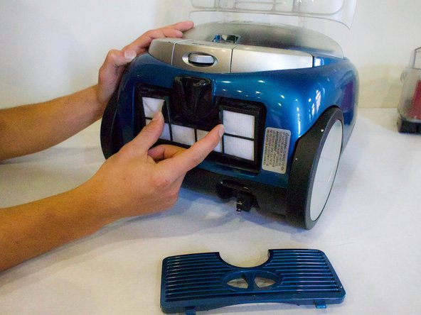 Place fingers on each tab on the Post-Motor HEPA Media Filter and pull out.