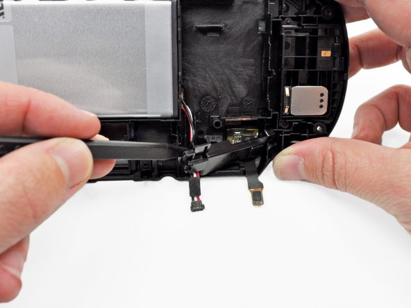 The easiest access to the battery cable retainer is where the battery cable comes out.