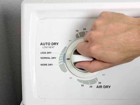 Set the dryer on a low-heat setting with a normal dry-cycle time.