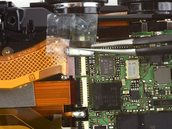 Image 3/3: Disconnect both ribbon cables.