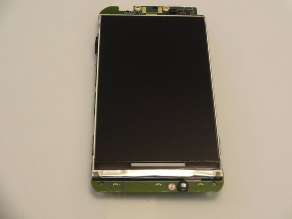 With the device completely disassembled, the LCD can easily be accessed. It is pictured here, in which it adheres to the front of the motherboard.