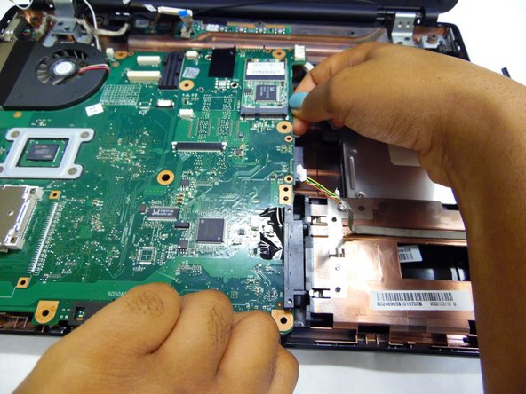Place  both hands on the front and right side of the motherboard, using your thumb and index finger, pinch it off of the latches.