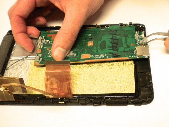 To gain access to the charging port, flip the motherboard over.