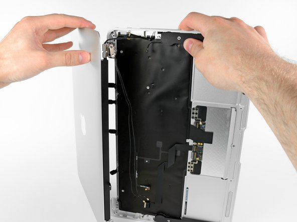 Once the two display hinges have cleared the upper case, remove the display and set it aside.