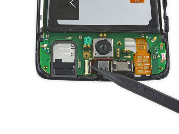Use the pointed end of a spudger to flip up the black retaining flap of the front facing camera's ZIF connector.